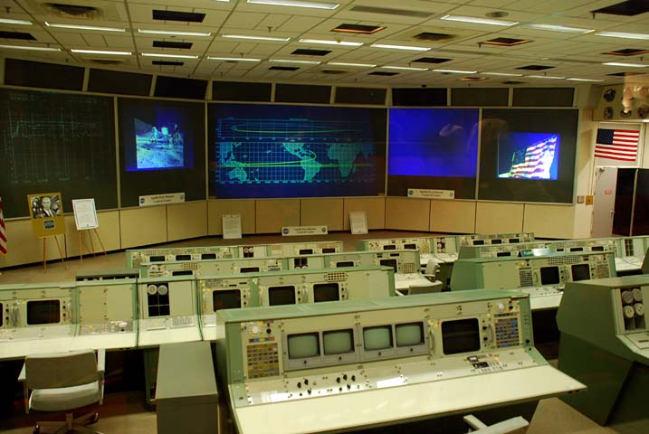Vintage NASA space flight control room with computer banks and large screens