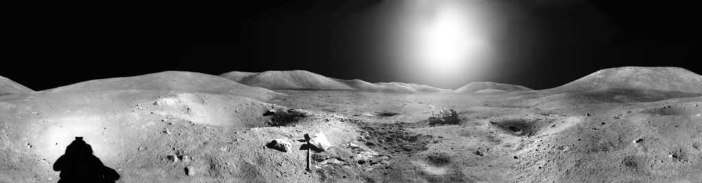 Panoramic moonscape with rover in distance