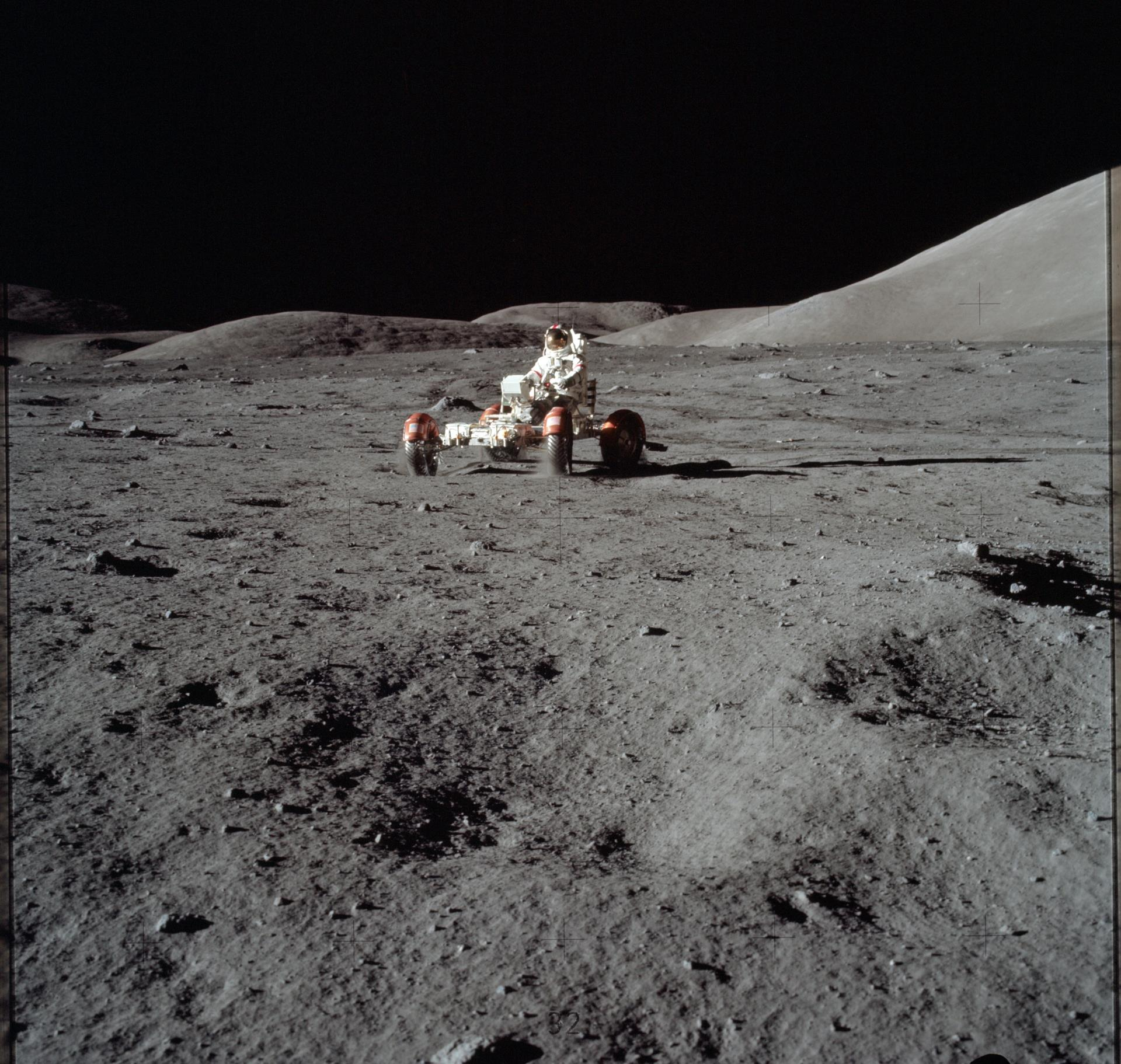 Astronaut driving moon buggy on the moon