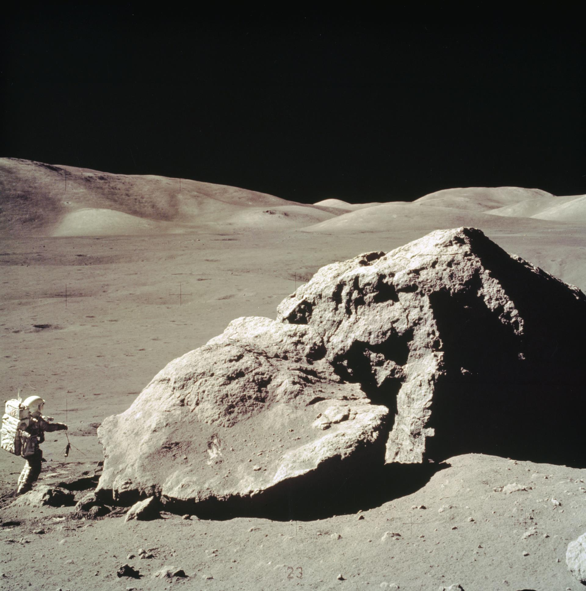 Astronaut collecting moon rocks