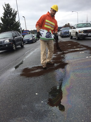 Spill cleanup on road to protect water quality