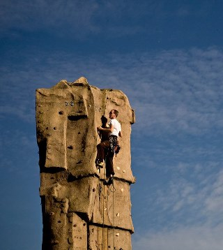 climber on artificial rock pinnacle